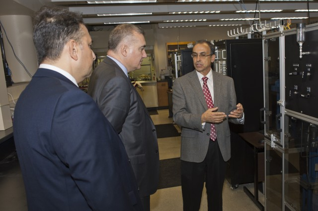 The Azerbaijani Ambassador to the United States, Elin Suleymanov, receives a tour of the Shale Laboratory in the University of Oklahoma's Petroleum and Geological Engineering from Professor Carl Sondergeld.