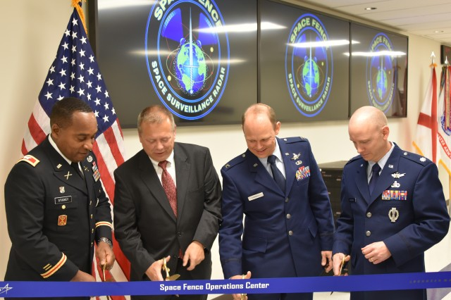 From left, Col. Rod L. Stuckey Sr., director, Ronald Reagan Test Ballistic Missile Defense Test Site; Bruce Schafhauser, program manager for the Lockheed Martin Space Fence program; Air Force Col. Wallace Turnbull, deputy director of the Space Superiority System Directorate; and Air Force Lt. Col. Brian McMenamy, deputy program manager, Space Fence Program Office; prepare to cut the ceremonial ribbon at the Space Fence Ribbon Cutting ceremony at the Reagan Test Site Operations Center-Huntsville, or ROC-H, Nov. 15.