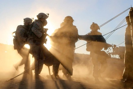 Soldiers carry a simulated casualty to a collection point during training at the National Training Center at Fort Irwin, Calif., Nov. 11, 2016.