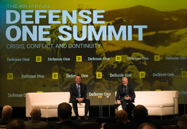 Army Secretary Eric Fanning, left, discusses administrative transition