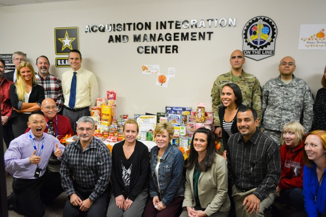 Soldiers and civilians collect food for donation to River Bend Foodbank at the Acquisition, Integration and Management Center, U.S. Army Sustainment Command, Rock Island Arsenal, Nov. 17.