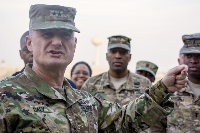Maj. Gen. Edward Daly, commanding general, U.S. Army Sustainment Command speaks with 401st Army Field Support Brigade personnel during his visit at Camp Arifjan, Kuwait, Nov. 17. (U.S. Army Photo by Justin Graff, 401st AFSB Public Affairs)