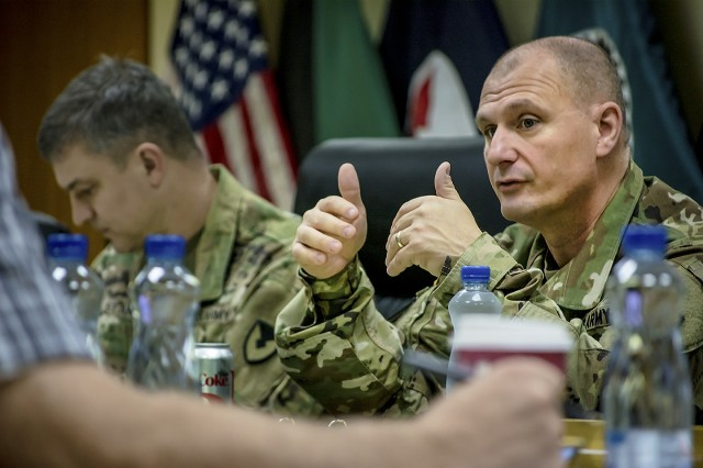 Maj. Gen. Edward Daly, commanding general, U.S. Army Sustainment Command discusses materiel readiness with 401st Army Field Support Brigade personnel during his visit at Camp Arifjan, Kuwait, Nov. 17. (U.S. Army Photo by Justin Graff, 401st AFSB Public Affairs)