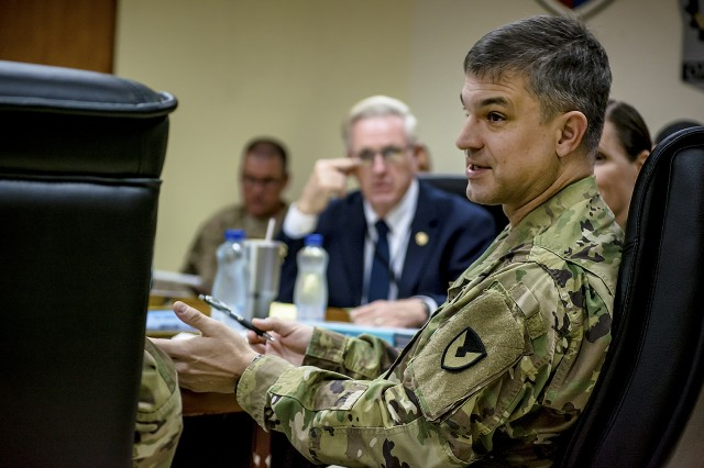 Col. Aaron Stanek, commander, 401st Army Field Support Brigade discusses materiel readiness with key logistics personnel at Camp Arifjan, Kuwait, Nov. 17. (U.S. Army Photo by Justin Graff, 401st AFSB Public Affairs)