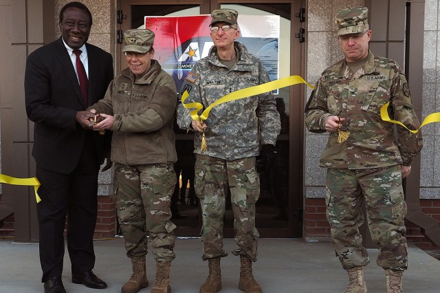 American Forces Network Korea officially opened its new broadcast facility at Camp Humphreys on Nov. 15. Show here cutting the ribbon are, from left: Ray Shepherd, Director Defense Media Activity, Maj. Gen. Tammy Smith, Eighth Army Deputy Commanding General-Sustainment, Maj. Gen. James T. Walton, Director of Transformation and Restationing, U.S. Forces Korea and U.S. Army Garrison Humphreys commander Col. Joseph C. Holland.