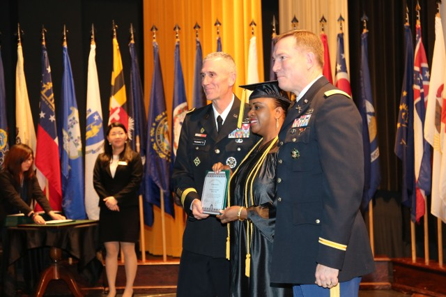 Sgt. 1st Class Kimara White; center, assigned to U.S. Army Japan, who graduated with an associate's degree, takes a photo with Maj. Gen. James F. Pasquarette; left, commander of U.S. Army Japan & I Corps (Forward) and Col. William B. Johnson; right, commander of U.S. Army Garrison Japan, during a graduation recognition ceremony hosted by CZEC Nov. 15 at CRC on Camp Zama. (U.S. Army Photos by Noriko Kudo)