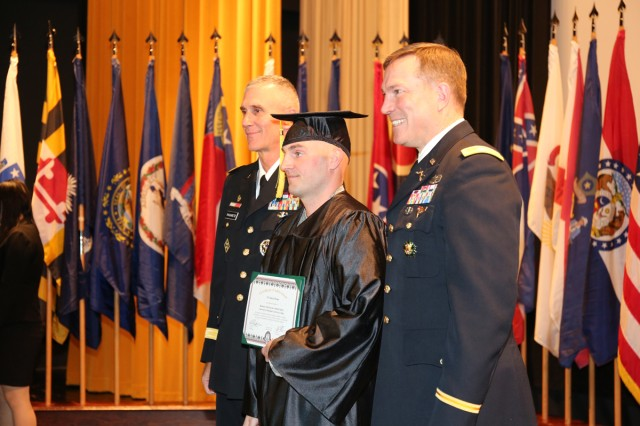 Sgt. 1st Class David Thorpe; center, assigned to US Army Japan, graduated with a bachelor's degree, takes a photo with Maj. Gen. James F. Pasquarette; left, commander of U.S. Army Japan & I Corps (Forward) and Col. William B. Johnson; right, commander of U.S. Army Garrison Japan, during a graduation recognition ceremony hosted by CZEC Nov. 15 at CRC on Camp Zama. (U.S. Army Photos by Noriko Kudo)