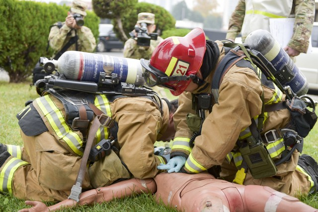 Firefighters perform CPR on a victim of an explosion during the USAG Daegu Full Scale Exercise.