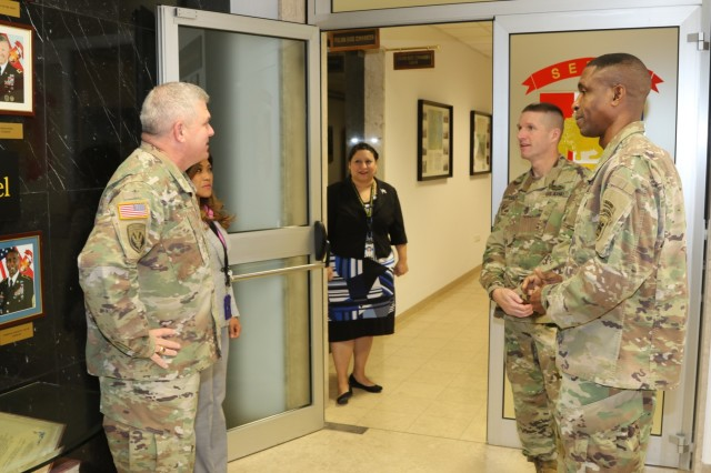 U.S. Army's most senior enlisted leader, Sgt. Maj. of the Army Daniel Dailey, talks with Brig. Gen. Kenneth Moore, U.S. Army Africa deputy commander and Command Sgt. Maj. Christopher Gilpin, USARAF's senior enlisted leader during a visit to the USARAF Headquarters Nov. 17, 2016, on Caserma Ederle in Vicenza, Italy. Dailey's visit included tours of the installations and discussions with the Soldiers and senior leaders of some of the tenant units located here. (U.S. Army Africa photo by: Staff Sgt. Lance Pounds)