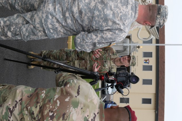 U.S. Army's most senior enlisted leader, Sgt. Maj. of the Army Daniel Dailey, gives an interview with Staff Sgt. Joshua Tverberg, U.S. Army Africa command information chief and broadcast journalist, Nov. 17, 2016, in front of the USARAF headquarters on Caserma Ederle in Vicenza, Italy. Present for the interview were representatives from the 173rd Airborne Brigade, American Forces Network and the Stars and Stripes newspaper. (U.S. Army Africa photo by: Staff Sgt. Lance Pounds)