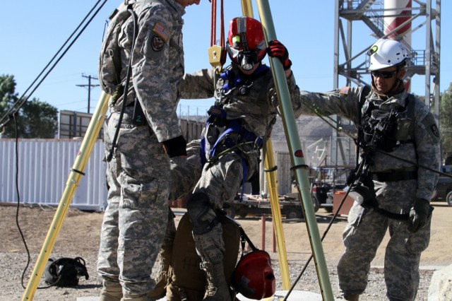 Engineers with the 235th Engineer Company (Sapper) hoists a medical technician with the 144 Fighter Wing into a confined space during search and rescue operations at the Del Valle Regional Training Center Nov. 17 during Vigilant Guard, a disaster response exercise. The exercise took place Nov. 14-18, and called upon members of the California, Nevada and Hawaii National Guards and Federal Emergency Response Agency Region IX to respond to an earthquake in Nevada and subsequent aftershock in Los Angeles.