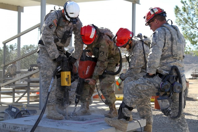 Engineers with the 235th Engineer Company (Sapper) use jack hammers to breach a confined space for search and rescue operations at the Del Valle Regional Training Center Nov. 17 during Vigilant Guard, a disaster response exercise. The exercise took place Nov. 14-18, and called upon members of the California, Nevada and Hawaii National Guards and Federal Emergency Response Agency Region IX to respond to an earthquake in Nevada and subsequent aftershock in Los Angeles.