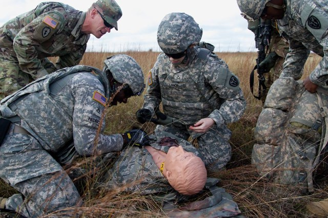 Soldiers with the 303rd MI Battalion, 504th Military Intelligence Brigade, treat a simulated casualty during training with the 1st Medical Brigade and 1st Air Cavalry Brigade.