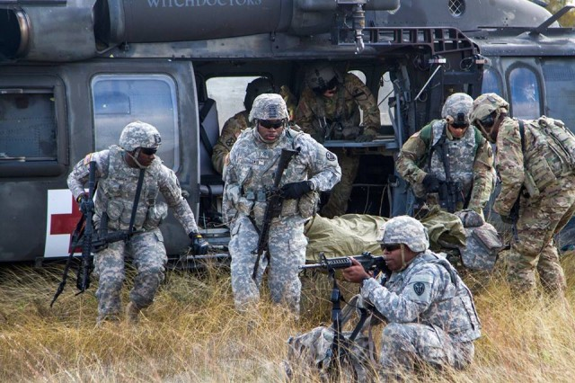 Soldiers with the 303rd Military Intelligence Battalion prepare to load a simulated casualty onto a UH-60 Blackhawk helicopter from the 1st Air Cavalry Brigade during Tactical Combat Casualty Care training, Nov. 17.