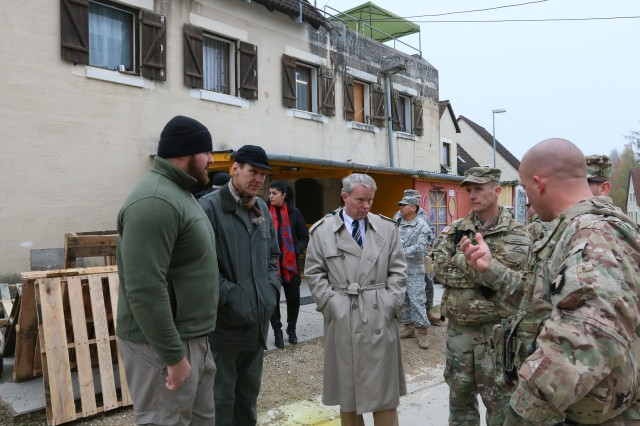U.S. Ambassador to Kosovo, Greg Delawie, center, meets with Col. Curtis Buzzard, JMRC Commander Operations Group, after a Crowd Riot Control event during a Kosovo Force (KFOR) mission rehearsal exercise (MRE) at the Joint Multinational Readiness Center in Hohenfels, Germany, Nov. 4, 2016.  The KFOR MRE 22 is designed to prepare the 37th Infantry Brigade Combat Team for peace support, stability, and contingent cooperation's in Kosovo in support of civil authorities to maintain a safe and secure environment. KFOR 22 hosts 1200 soldiers from 9 nations. The exercise runs from Oct. 18 through Nov. 10 in Hohenfels, Germany.  (U.S. Army photo by Sgt. Karen S Sampson USAREUR)