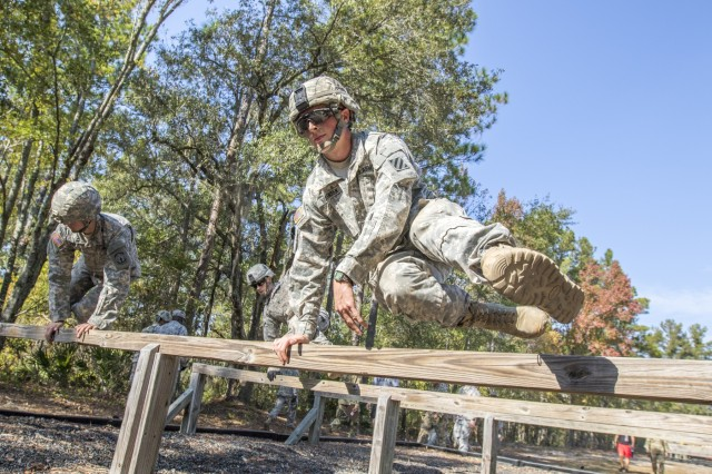 2nd Lt. Nicholas Mogensen, 5th Squadron, 7th Cavalry Regiment, 1st Armored Brigade Combat Team jumps over an obstacle as he competes for the Best Lieutenant completion during Marne Week on Fort Stewart November 15. Photo by Spc. Scott Lindblom, 3rd CAB Public Affairs.