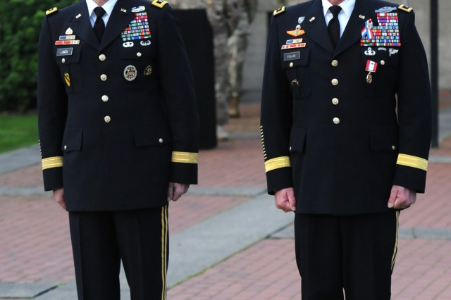 Maj. Gen. William K. Fuller (right), former deputy commanding general of I Corps and Lt. Gen. Stephen R. Lanza, commanding general of I Corps, stand at attention during Fuller's retirement ceremony at Joint Base Lewis-McChord, Wash., Nov. 18. Fuller retired after 35 years of military service. (U.S. Army photo by Sgt. Sinthia Rosario, 5th Mobile Public Affairs Detachment)