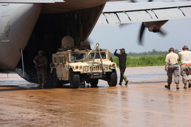The Army is providing lighter weight, more transportable configurations of its tactical communications network backbone, WIN-T, including the air transportable High Mobility Multipurpose Wheeled Vehicle used here by the 3rd BCT 82nd ABN DIV during its recent JRTC rotation at Fort Polk. The Point of Presence, being unloaded from an aircraft, enables connectivity so commanders can receive mobile mission command including a near real time common operating picture from anywhere on the battlefield. (U.S. Army photo by JRTC/Fort Polk Public Affairs)