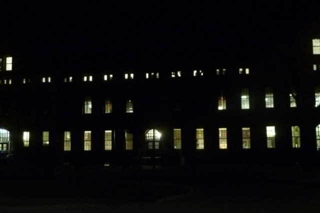 A photo of the exterior of Bldg. 68 on Rock Island Arsenal the night of the night-light survey. Numerous lights can be seen illuminated on the inside of the facility.