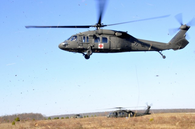 A UH-60 Black Hawk helicopter assigned to Charlie Company, 2-104th General Support Aviation Battalion, 28th Combat Aviation Brigade, Pennsylvania Army National Guard takes off from a Forward Arming and Refueling Point at Mid-State Regional Airport.