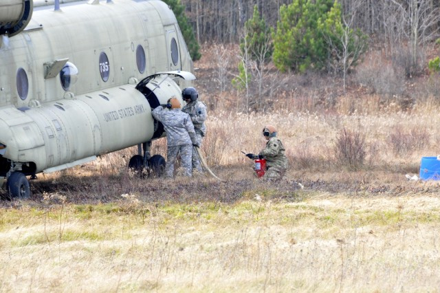 U.S. Soldiers with Echo Company, 2-104th General Support Aviation Battalion, 28th Combat Aviation Brigade, Pennsylvania Army National Guard refuel a CH-47 Chinook helicopter at a Forward Arming and Refueling Point at Mid-State Regional Airport.