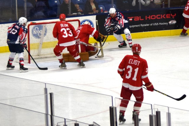 Michigan Warriors player Justin Dunn attempts a goal against the Detroit Red Wings Alumni team during a charity game Nov. 19, 2016, in Plymouth, Mich. The Alumni won 7-5 after two 25-minute periods. Each member of the Warriors team is a military veteran with a service-connected disability or has received a Purple Heart.
