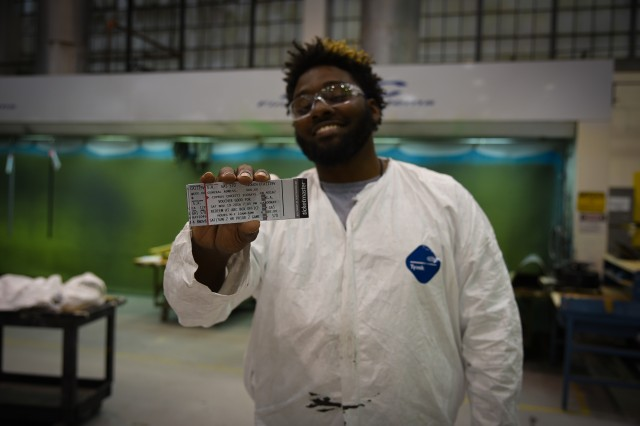 A Corpus Christi Army Depot employee shows off the free tickets he received to the Corpus Christi IceRays game against the Lone Star Brahmas on Stars & Stripes Night.