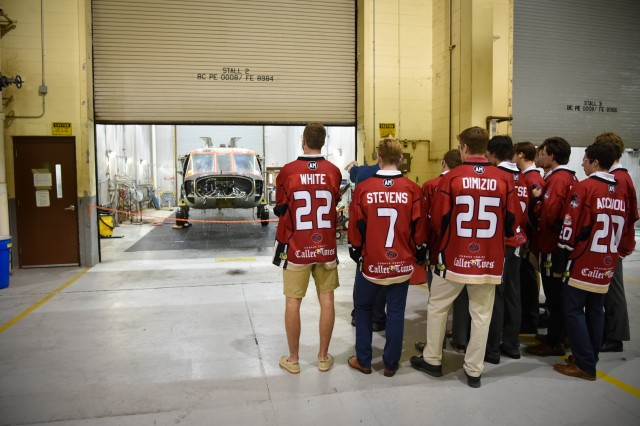 Col. Allan Lanceta, commander of the Corpus Christi Army Depot, Texas, gives a tour of the depot's facilities to members of the Corpus Christi IceRays ice hockey team.