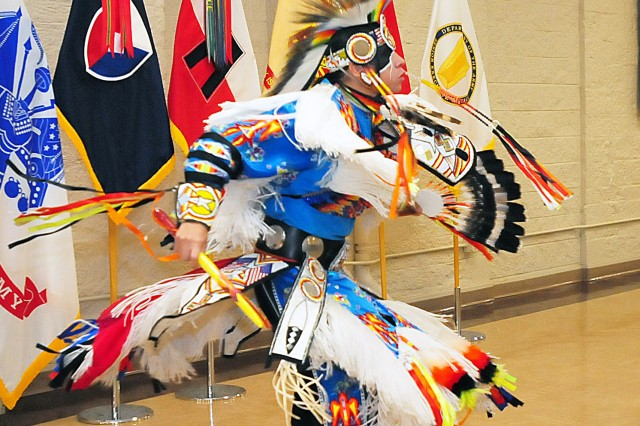 Ronnie Preston performs the grass dance during the National American Indian Heritage Month observance Nov. 21 in Heritage Hall at Rock Island Arsenal, Illinois. Preston, who resides in Milwaukee, is a member of the San Carlos Apache Nation, Arizona. (Photo by Jon Micheal Connor, ASC Public Affairs)