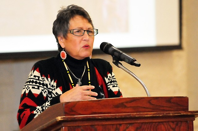"Retired Army Maj. Jo Ann Schedler shares the history of the Mohican Nation, Stockbridge-Munsee Band of Indians from Wisconsin, Nov. 21 in Heritage Hall at Rock Island Arsenal, Illinois. Schedler, who is a member of the of the Stockbridge-Munsee band, is author of a chapter ""Wisconsin American Indians in the Civil War"" in the Official National Park Service handbook ""American Indians and the Civil War."" (Photo by Jon Micheal Connor, ASC Public Affairs)"