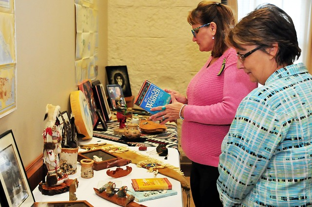 Attendees check out artifacts in support of National American Indian Heritage Month observance Nov. 21 in Heritage Hall at Rock Island Arsenal, Illinois. (Photo by Jon Micheal Connor, ASC Public Affairs)
