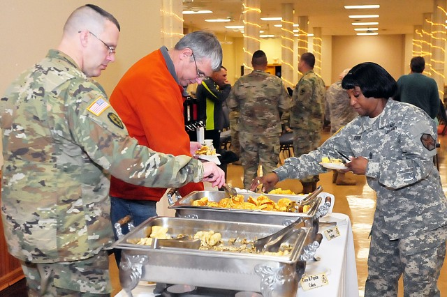 Col. Shawn Klawunder, First U.S. Army chief of staff, and Command Sgt. Maj. Myris Dixon, U.S. Army Garrison -- Rock Island Arsenal, sample Native American food in support of National American Indian Heritage Month observance Nov. 21 in Heritage Hall at RIA, Illinois. (Photo by Jon Micheal Connor, ASC Public Affairs)