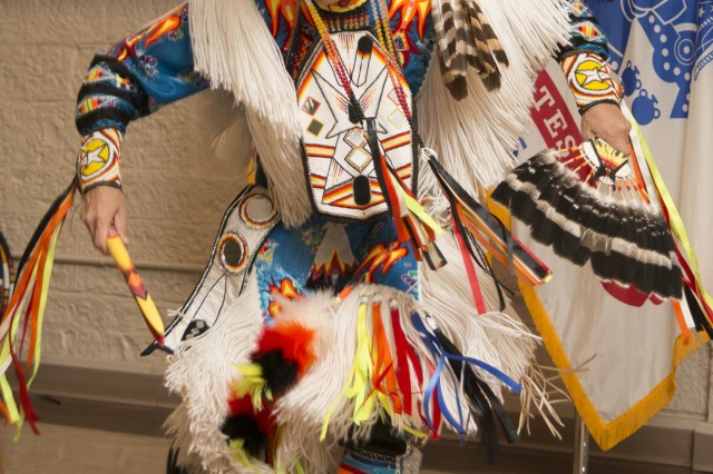 Ronald Preston, a member of the San Carlos Apache Nation in Arizona, dances at a National American Indian Heritage Month Observance hosted by First Army at Rock Island Arsenal, Ill., Nov. 21, 2016. The event also featured a presentation by retired Army Maj. Jo Ann Schedler, a member of the Mohican Nation in Wisconsin. (Photo by Staff Sgt. Ian M. Kummer, First Army Public Affairs)