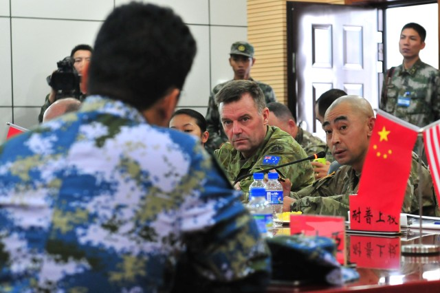 Maj. Gen. Gregory Bilton (Center), the deputy commanding general of U.S. Army Pacific, listens to questions from a member of the People's Liberation Army of the People's Republic of China during the U.S.-China Disaster Management Exchange November 15 in Kunming, China. The annual United States Army Pacific (USARPAC) Security Cooperation event with the PLA is an opportunity to share Humanitarian Assistance/Disaster Relief lessons learned from real world events and enhance U.S. and Chinese disaster management capabilities