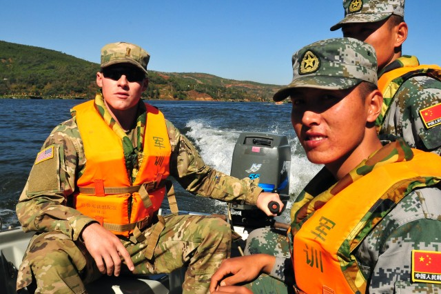2nd Lt. Thomas Shade, a platoon leader with the 84th Engineer Battalion, 130th Engineer Brigade, 8th Theater Sustainment Command, receives instruction on how to properly operate a boat in water rescue operations from members of the People's Liberation Army of the People's Republic of China during the practical field exchange portion of the U.S.-China Disaster Manage Exchange November 16 in Kunming, China. The annual United States Army Pacific (USARPAC) Security Cooperation event with the PLA is an opportunity to share Humanitarian Assistance/Disaster Relief lessons learned from real world events and enhance U.S. and Chinese disaster management capabilities.