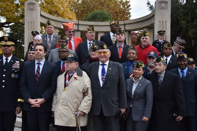 Soldiers and family members pose for a group photo following the Veterans Day ceremony.
