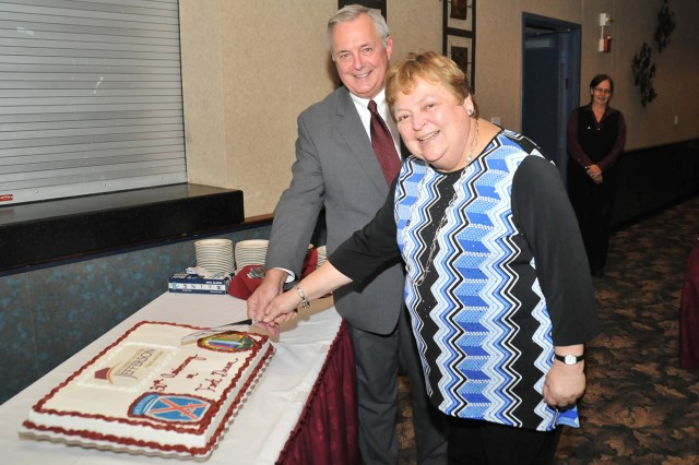 Donald Johnson, Jefferson Community College director of military programs and Carole McCoy, JCC president, cut the cake during the 30-year anniversary celebration between JCC and Fort Drum.