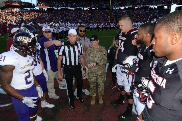 Sgt. Amanda Reuter, a chaplain's assistant and Fort Jackson Soldier of the Year, prepares to toss the coin during the University of South Carolina Military Appreciation Day game Nov. 19.