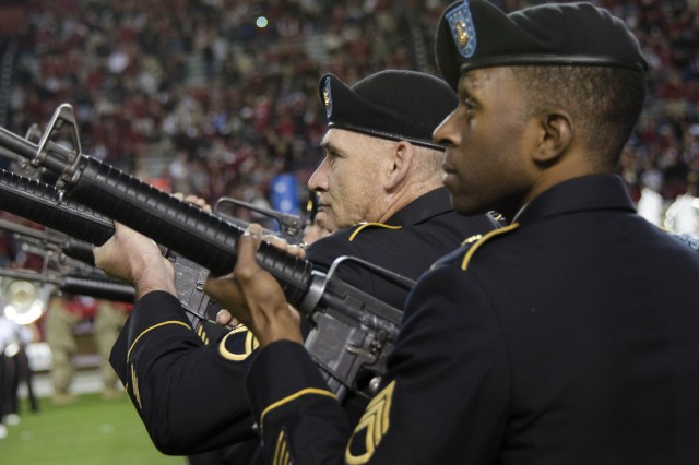 Members of the Fort Jackson honor guard fire a volley to honor Service members lost during service to their country during the halftime celebration at the University of South Carolina's Military Appreciation Day game Nov. 19 at Williams Brice Stadium in Columbia, S.C.