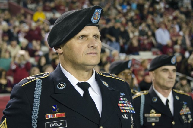 Sgt. 1st Class Stefan Kassza, with Fort Jackson's operations office and leader of the post's honor guard, prepares to march his troops onto the field during halftime celebrations Nov. 19. The University of South Carolina honored Fort Jackson during their annual Military Appreciation Game.