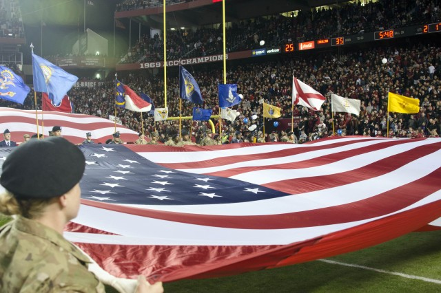Soldiers in training from Fort Jackson hold a giant U.S. flag tight during the halftime celebration of the University of South Carolina's 2016 Military Appreciation Day game, Nov. 19 at Williams-Brice Stadium in Columbia, S.C.