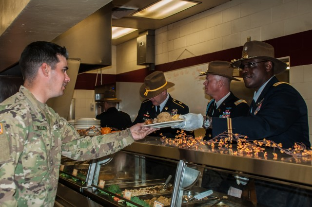Lt. Col. Ryan Moses (right), squadron commander, Regimental Support Squadron, 11th Armored Cavalry Regiment, Fort Irwin, California, continues the Army tradition of serving Thanksgiving meals, Nov. 22, 2016.