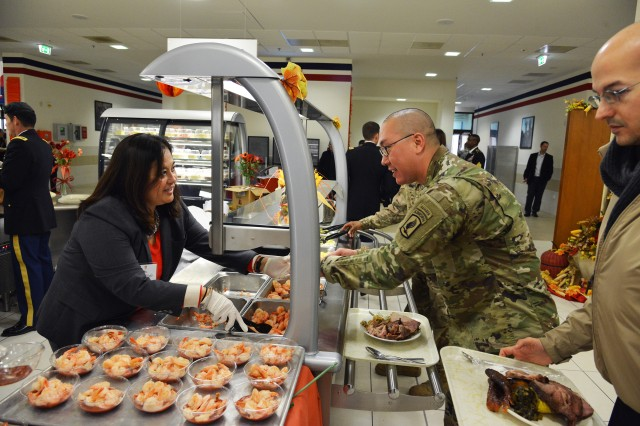 Assistant Secretary of the Army for Manpower & Reserve Affairs Debra S. Wada serves lunch to paratroopers from the 173rd Airborne Brigade, during the Thanksgiving lunch celebration at Caserma Del Din in Vicenza, Italy Nov. 22, 2016.
