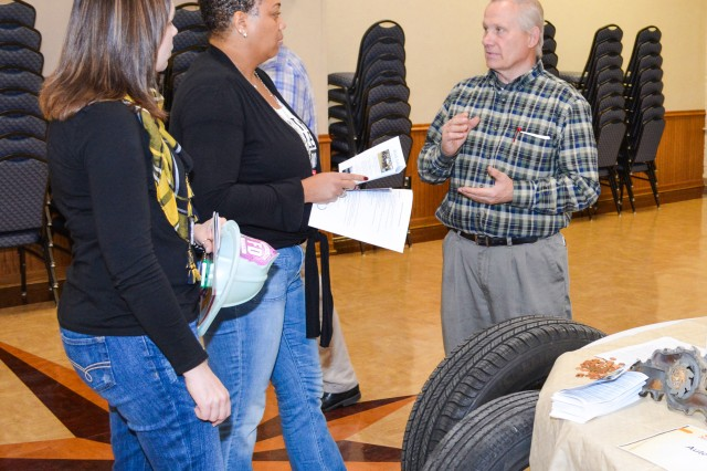 Jim Mettlin, Auto Craft shop manager, explains tire tread depth to Rock Island Arsenal personnel at his information booth, here, Nov. 18.