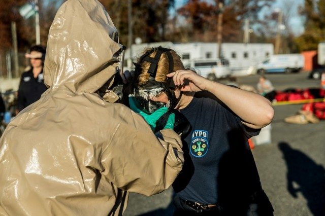 A New York City Police officer assigned to the NYPD's  Chemical Ordnance, Biological and Radiological Awareness (COBRA) unit goes through decontamination during a joint exercise with New York Army National Guard Soldiers of the 222nd Chemical Company, based at Fort Hamilton, Brooklyn, N.Y. at the NYPD's Rodman's Neck Tactical Village in the Bronx, N.Y., on Saturday  Nov. 19, 2016.The National Guard Soldiers and the members of the ploces of the COBRA  Training Unit used the exercise to share techniques and procedures, and enhance readiness in case of a disaster or terrorist attack.
