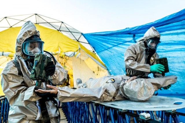 New York Army National Guard Soldiers of the 222nd Chemical Company, based at Fort Hamilton, Brooklyn, N.Y.  check a casualty during a  training exercise simulating a joint response to a chemical attack and decontamination situation with the New York Police Department's Chemical Ordnance, Biological and Radiological Awareness (COBRA) unit at Rodman's Neck Tactical Village in the Bronx, N.Y., on Saturday  Nov. 19, 2016.The National Guard Soldiers and the members of the ploces of the COBRA  Training Unit used the exercise to share techniques and procedures, and enhance readiness in case of a disaster or terrorist attack.