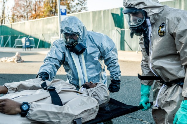 A New York Army National Guard Soldier of the 222nd Chemical Company, based at Fort Hamilton, Brooklyn, N.Y.  (right) conducts a simulated decontamination with a member of the  New York Police Department's Chemical Ordnance, Biological and Radiological Awareness (COBRA) unit at Rodman's Neck Tactical Village in the Bronx, N.Y., on Saturday  Nov. 19, 2016.The National Guard Soldiers and the members of the ploces of the COBRA  Training Unit used the exercise to share techniques and procedures, and enhance readiness in case of a disaster or terrorist attack.
