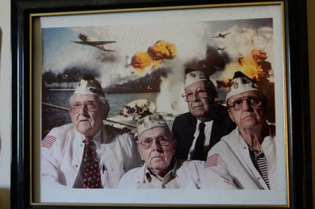 A photo of Bob McKenney (left), Richard Schimmel (center bottom), and two other Pearl Harbor survivors hangs in Schimmel's home office. DoD photo by Katie Lange