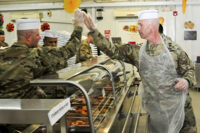 Service members celebrated Thanksgiving Day Nov. 24, 2016 at Camp Arifjan, Kuwait. Soldiers enjoyed traditional cuisine served by numerous organizations leaders, senior service members and guest visitors. The holiday festivities also included a morning Turkey Trot 5k.