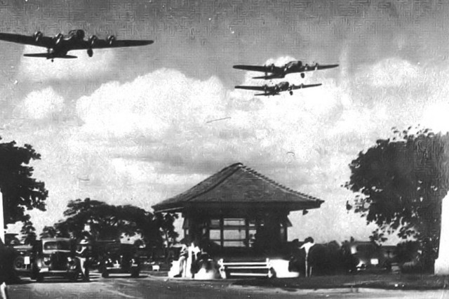 Boeing B-17D Fortresses of the 5th Bombardment Group overfly the main gate at Hickam Field, Hawaii territory during the summer of 1941. 21 B-17C/Ds had been flown out to Hawaii during May to reinforce the defenses of the islands.